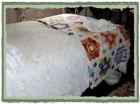 Vintage bed with vintage hexagon quilt