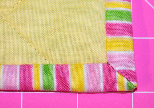 How To Bind Your Quilt Using Stitched Mitered Corners